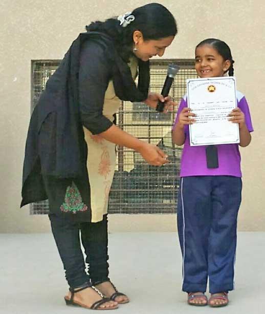 Disha Ashok of Grade II participated in Geeta Gayana Yagna - Jain Heritage School